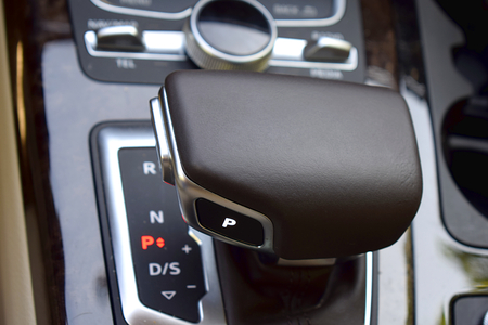 Gearshift lever in a modern car. The cereal plan.
