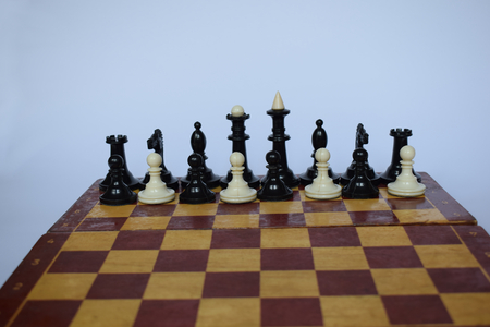 The abstract position of figures on the chessboard, associated with a foreign legion, that is, a team of people of different nationalities.