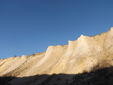 The wall of an old quarry for sand mining.