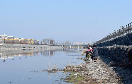 Ukraine, Bahmut, April 4, 2018. The fishermen came to the bank of the river on the first fine spring day.