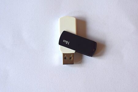 White USB flash drive on a light background close-up. 版權商用圖片