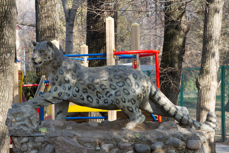 sported: sculpture of snow leopards in Almaty zoo along the road