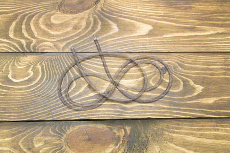 coil of wire on the table of the old boards photo