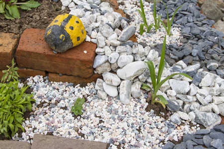 back yard pond: rock garden in the front garden in early spring Stock Photo