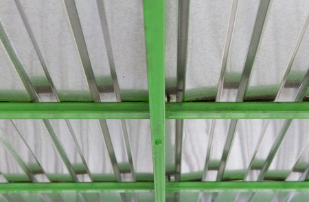 roof of galvanized iron with green beams photo