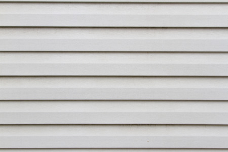 structure white siding on the facade of the horizontal Reklamní fotografie