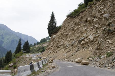 landslide on the mountain road leading to the top Reklamní fotografie