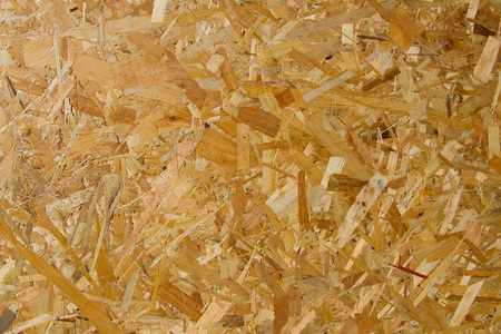 osb: OSB sheet structure with large patches of sawdust and shavings