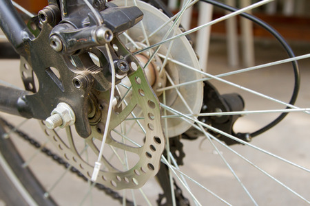brake disc: bicycle brake disc with punching and cables Stock Photo