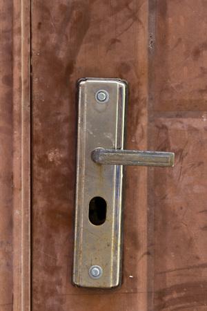 old buildings: oor handle on an old metal door Stock Photo