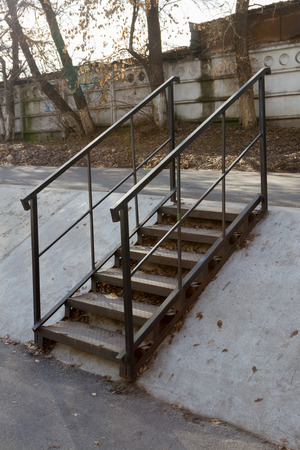 steps and staircases: Metal ladder mounted on the embankment of the river Stock Photo