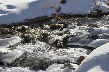 frozen creek: frozen creek in winter with snow clearing Stock Photo