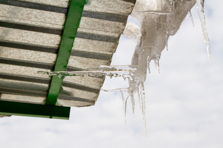 horizontal position: icicles on a roof in the vertical and horizontal position
