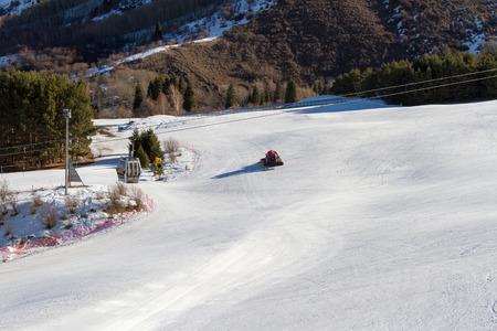 snowcat: snowcat on ski slopes in the early morning Stock Photo