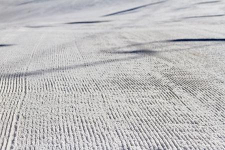 snowcat: ski slope with ski lifts after a snowcat