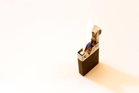 gas lighter: A working gas lighter on a white background