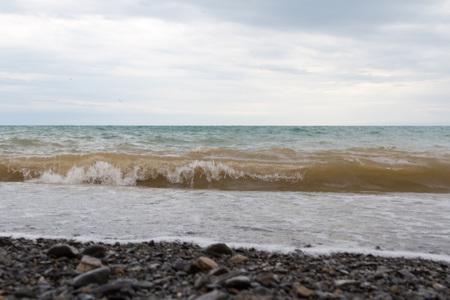 black pebbles: shore of a mountain lake Alakol with black pebbles Stock Photo