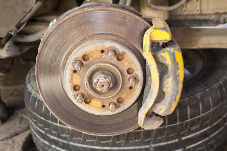 Brake disc with caliper on the vehicle heavily worn