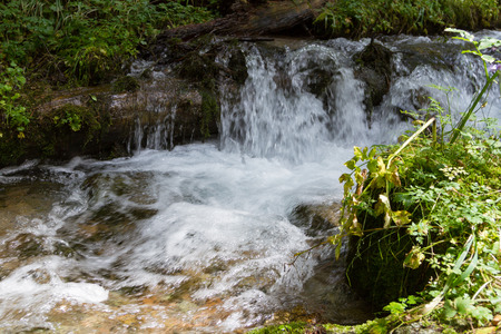 threshold: Small stream in the mountains with a small threshold