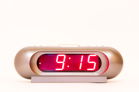 oclock: electronic clock alarm clock with red illumination and the time 9:15