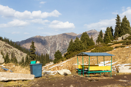 wheelie bin with a gazebo for relaxing in the mountains