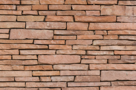 wall decor: The wall built of stones of different sizes decor