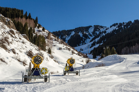 Snow guns along the route to the ski resort Stock Photo