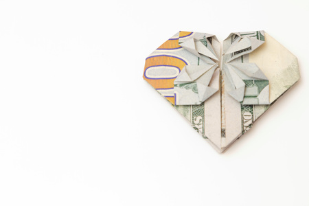 dollar bill folded heart on a white background Stock Photo