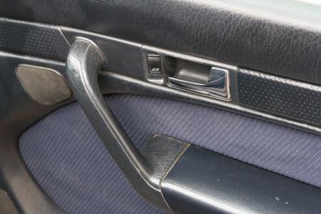 door casing: Casing on the car door with handle and window lift button