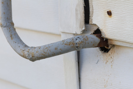 corroded: Rusty gas pipe passing through the wall into the house Stock Photo