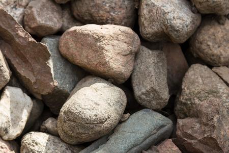 Texture of a pile of granite cobblestones Stock Photo