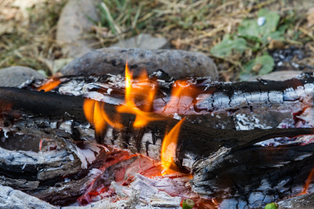 coals in the fire from burnt firewood