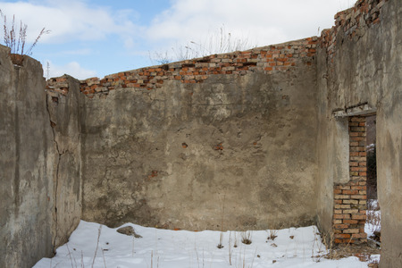 abandoned old brick building in the mountains without a roof