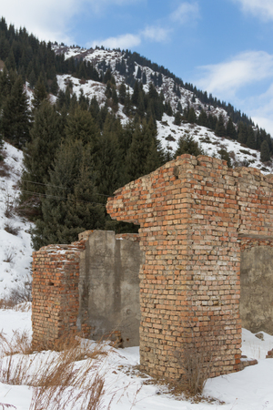 destroyed old brick building in the mountains without a roof