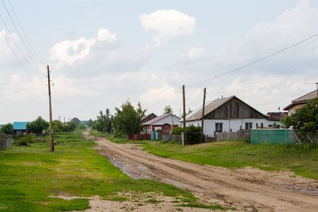 street in the Russian village with a dirt road near Omsk