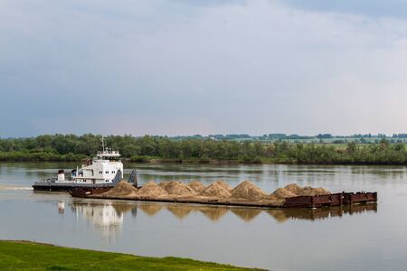 transportation of sand on a barge along the Irtysh River