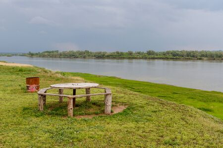 picnic table from the reel of cable on the banks of the Irtysh River