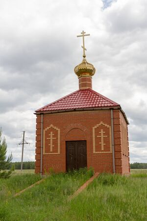 Chapel on the churchyard in the Russian village Reklamní fotografie