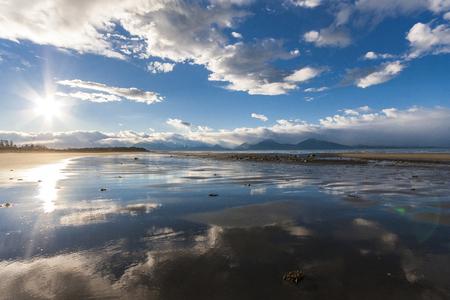 Reflection of sky in sandy beach of Alaska. Near Homer. Reklamní fotografie