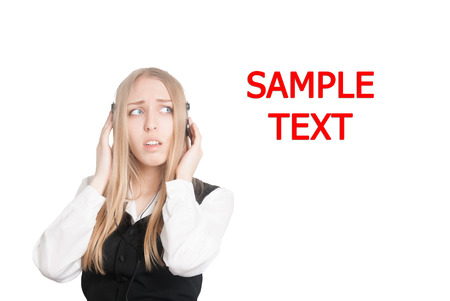 hands free phone: Closeup portrait of a worried customer service representative or young business woman, speaking on hands free phone, with copyspace (isolated on white background)