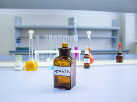 nitrate: Brown glass bottle containing silver nitrate in a chemical laboratory, blurred background