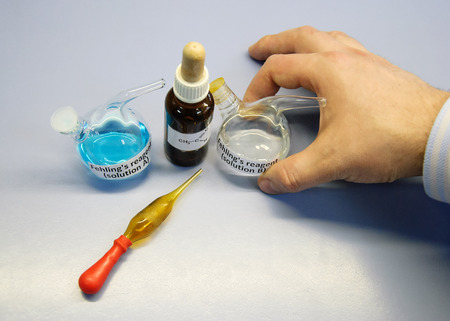 Scientist going to carry out an experiment using Fehlings A and Fehlings B solutions Stok Fotoğraf