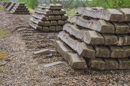 folded concrete sleepers on abandoned disassembled railway