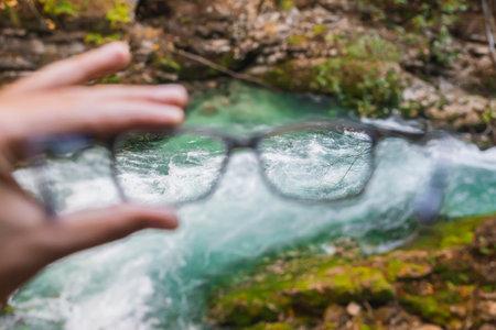 seething mountain river in Slovenia through glasses Standard-Bild