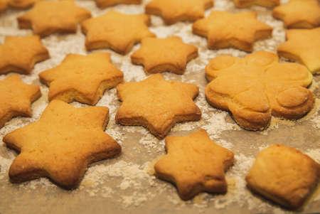 homemade shortbread in the shape of star on baking sheet