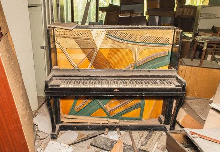 piano destroyed by marauders in Pripyat Ukraine