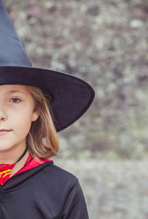 young fair-haired sorceress in mantle and hat Stockfoto