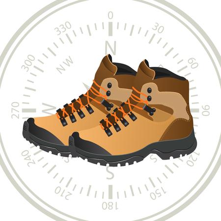 chaussures touristiques sur le fond d & # 39 ; une boussole