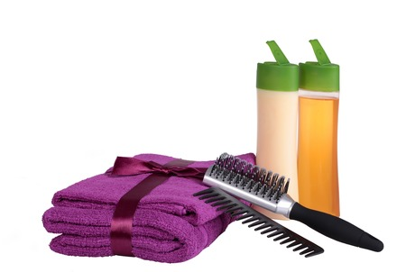 Spa or bathroom concept. Shampoo, towels and  hair brush isolated on white