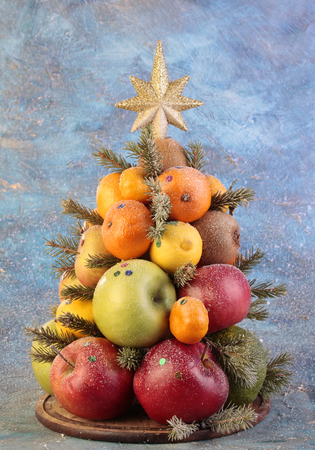 Fruit Christmas tree on the artistic background.